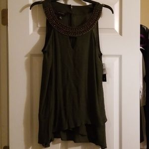 Sleeveless blouse with jewels/stones